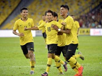 Pemain Harimau Malaya Mohd Faiz Nasir (tengah) meraikan jaringannya ketika menentang pasukan Timor- Leste pada Perlawanan Kelayakan Piala Dunia 2022 dan Piala Asia 2023 di Stadium Nasional Bukit Jalil malam ini. - Foto Bernama