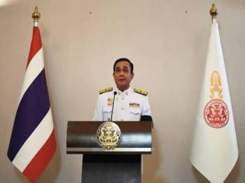 Prayut Chan-O-Cha yang dilantik secara rasmi menjadi Perdana Menteri Thailand ke-29 hari ini berjanji mendengar suara rakyat dan melindungi monarki.- Foto AFP