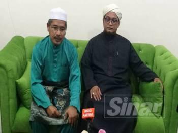 Nasruddin (kanan) bersama Ahmad Fakhruddin (kiri) pada sidang media selepas Konvesyen Pas Kedah 2019 di Kompleks Pas Kedah di Kota Sarang Semut, di sini, hari ini.