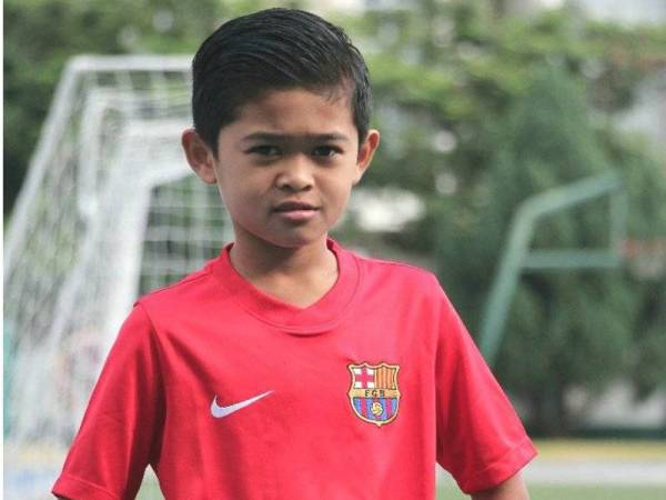 Muhammad Hazriq ketika menyertai latihan bersama Akademi Barcelona di Singapura.