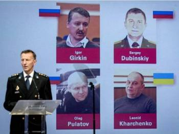 Igor Gerkin, Sergey Dubinsky, Oieg Pulatov dari Rusia manakala Leonid Kharchenko warganegara Ukraine dinamakan sebagai dalang utama insiden MH17 yang ditembak jatuh di timur Ukraine pada tahun 2014. - AFP