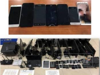 Peralatan komputer, komputer riba dan telefon pintar yang dirampas polis di dua unit pangsapuri di Seremban 2 semalam.