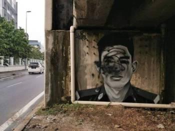 Mural arwah Adib yang diconteng pihak tidak bertanggungjawab.