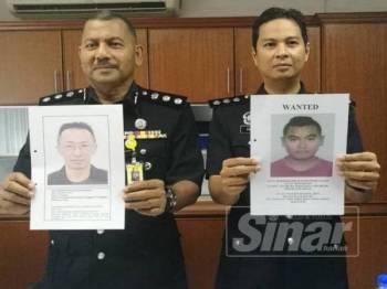 Razmi (kiri) bersama Pegawai Jabatan Siasatan Jenayah IPK Terengganu, Asisten Superintendan Mohd Faizal Ahmad Tajudin menunjukkan gambar dua individu dicari.