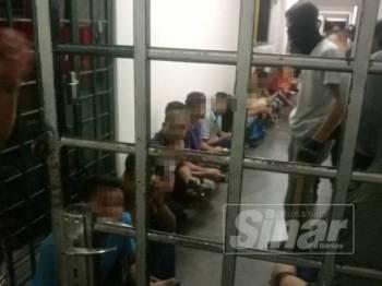 Sebahagian warga asing yang ditahan dalam Ops Sapu di sebuah apartment di Jalan Segambut, di sini, awal pagi tadi.