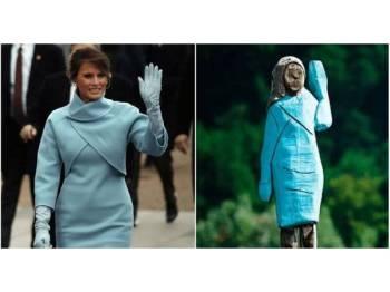 Patung tersebut 'memakai' pakaian sama dipakai Melania ketika pelantikan suaminya, Donald Trump sebagai Presiden AS. - Foto meaww.com
