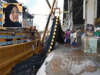 Bot nelayan mendarat ikan di jeti Kompleks LKIM Kemunting di sini. Gammbar kecil: Rashima