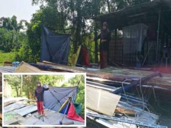 Nasuha menunjukkan keadaan kedai yang rosak akibat dipukul ribut dalam kejadian petang semalam.