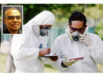 Anggota Jabatan Alam Sekitar (JAS) melakukan pemeriksaan bacaan kualiti udara di kilang-kilang berhampiran kawasan Pasir Gudang, baru-baru ini. (Gambar kecil: Wan Abdul Latiff) - Foto Bernama. (Gambar kecil: Wan Abdul Latiff)