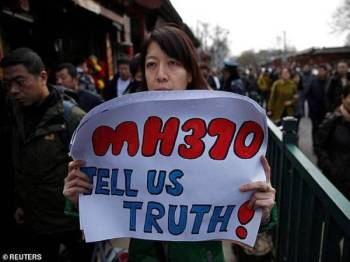 Misteri kehilangan pesawat MH370 masih belum terjawab.