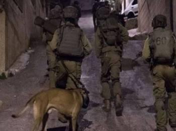 Tentera Israel menyerbu sebuah kawasan kejiranan Palestin di Semenanjung Gaza.