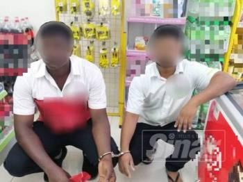 Dua dari tiga warganegara India yang ditahan di sebuah stesen minyak di Jitra, dekat sini.