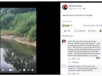 Tangkap layar daripada video tular menunjukkan seekor buaya sedang berehat di tebing Sungai Bengkal, Batu Pahat.