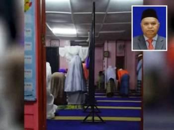 Rakaman amalan zikir sambil berdiri dengan menggerakkan tubuh badan yang dirakam di surau Kampung Bantal Seberang, Ulu Tembeling, Jerantut, Pahang. (Gambar kecil: Mat Azmi Arshad)
