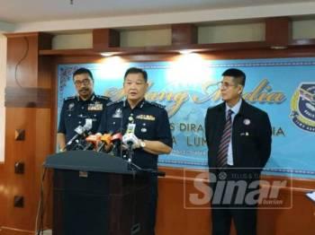 Ketua Polis Negara, Datuk Seri Abdul Hamid Bador (tengah) pada sidang media selepas merasmikan Majlis Jelajah Autisme: Garis Panduan PDRM, hari ini.