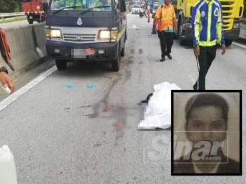 Mangsa maut di lokasi kejadian selepas parah diseret hampir sepuluh meter dalam kemalangan di KM5 Lebuhraya DUKE petang semalam.  (Mangsa: Mohammad Khairul Anuar)
