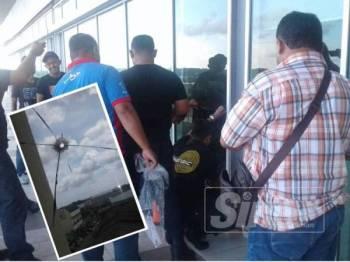 Polis menjalankan siasatan sebaik sahaja laporan dibuat pada dua tahun lalu. (Gambar kecil, kesan tembakan pada dinding kaca bangunan UMNO Pekan)