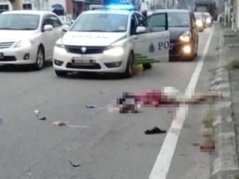 Mangsa mengalami kecederaan serius di kepala maut selepas dirempuh sebuah lori ketika melintas jalan di Kampar hari ini. - Foto IHSAN PEMBACA