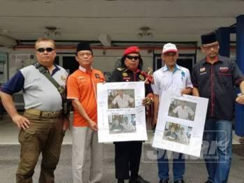 Presiden GMPN, Mejar (B) Razali Zakaria (kanan) selepas membuat laporan polis di IPD Wangsa Maju.