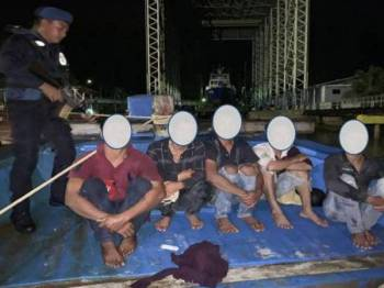 Warga Vietnam yang ditahan ketika Op Pensura Khas di kawasan perairan Pulau Langkayan.