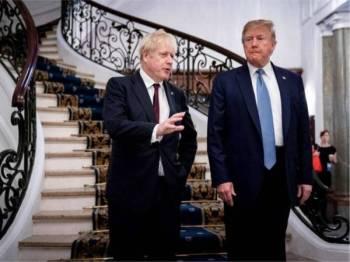 Presiden AS, Donald Trump (kanan) bersama Perdana Menteri Britain, Boris Johnson. - FOTO AFP