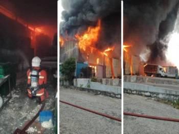 Anggota bomba bertungkus lumus memadamkan kebakaran melibatkan dua kilang di Jalan Industri, Kampung Baru Sungai Buloh semalam.  - Foto Ihsan JBPM Sungai Buloh