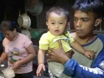Hadijah Haura telah diberi minum kopi sejak berusia enam bulan.- Foto Kompas