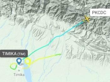 Pesawat Twin Otter DHC6-400 berlepas dari bandar Timika menuju ke Ilaga.