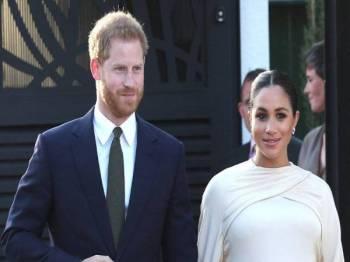 Putera Harry dan isterinya terpaksa mengambil tindakan undang-undang kerana 'kempen kejam' tabloid tersebut. FOTO: AGENSI