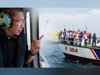Salahuddin meninjau pelupusan bot rampasan di perairan Pulau Kapas semalam. Gambar kecil: Salahuddin