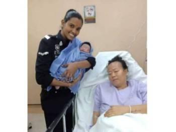 Komathi melawat wanita berkenaan dan bayinya di hospital. - Foto ihsan Polis KL