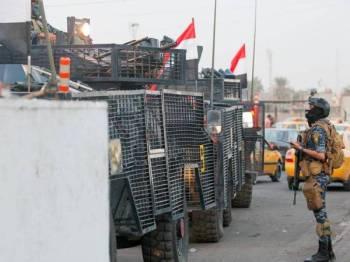 Pasukan polis diberikan kuasa semula untuk mengawal keselamatan di Sadr City semalam. - Foto AFP