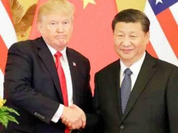 Trump (kiri) dijangka menandatangani perjanjian itu bersama Xinping ketika Sidang Kemuncak PBB pada Disember depan.