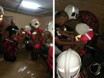 Usaha memindahkan warga emas terperangkap dalam banjir kilat di Kampung Sungai Gahal Hulu Langat petang tadi. Foto: JBPM Selangor