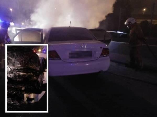 Pasukan bomba memadamkan kebakaran pada bahagian enjin kereta mangsa di Tambak Johor, awal pagi tadi. (Gambar kecil: Bahagian enjin kereta mangsa yang musnah 90 peratus.) - Foto Bomba Johor