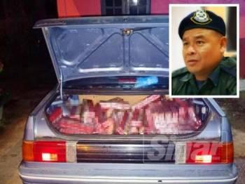 PGA Batalion 7 Kuantan menemui 610 karton rokok di dalam sebuah kereta jenis Proton Iswara pagi tadi. (Gambar kecil: Azhari)