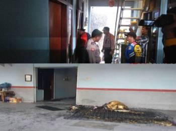 Seorang suami membakar isterinya hidup-hidup selepas berlaku pertengkaran di sebuah rumah tumpangan di Surabaya semalam. - Foto Agensi