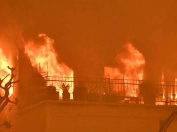 Tujuh maut termasuk lima kanak-kanak di Rusia dalam satu kebakaran rumah. -Foto Agensi