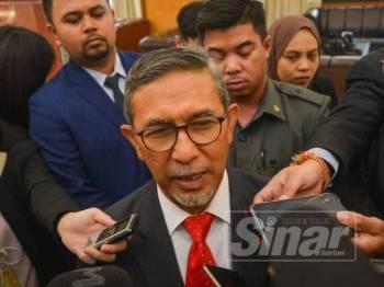 Rashid ketika ditemui media di lobi Parlimen di sini hari ini. - FOTO SHARIFUDIN ABDUL RAHIM