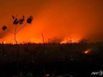Keluasan kawasan yang terjejas akibat kebakaran hutan di Indonesia sepanjang September tahun ini melebihi tahun lalu. - FOTO AFP