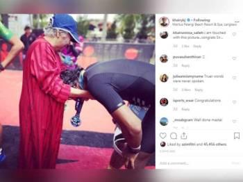 Perkongsian gambar ibu Khairy mengalungkan pingat sejurus menamatkan perlumbaan dengan jumlah jarak 113 kilometer mendapat pelbagai rekasi daripada netizen.