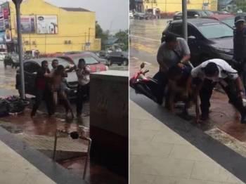 Suspek ditahan orang awam sebelum diserahkan kepada pihak polis untuk tindakan lanjut. - Foto ihsan pembaca
