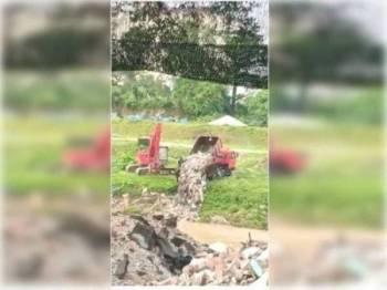 Lori dikesan membuang sampah di Sungai Klang menerusi video yang tular terbabit.