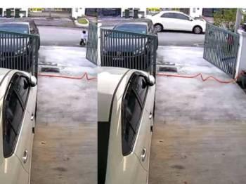 Tangkap layar video yang menunjukkan kanak-kanak dilanggar kereta di depan rumahnya.
