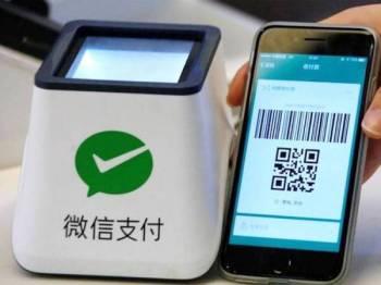 Ketika ini kebanyakan pembayaran menggunakan imbasan kod QR melalui Wechat Pay.