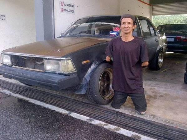 Pak Busu seorang mekanik di bengkel IM Auto Garage.
