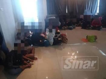 Antara individu yang ditahan polis dalam serbuan di sebuah kondominium di Jalan Ampang di sini semalam.