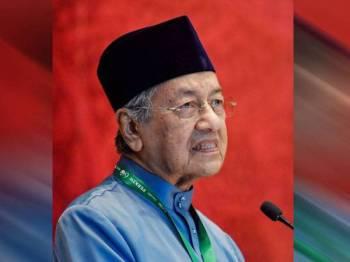 Dr Mahathir menyampaikan ucapan pada Mesyuarat Agung Tahunan Perkim Peringkat Kebangsaan Kali ke-58 hari ini. FOTO: BERNAMA
