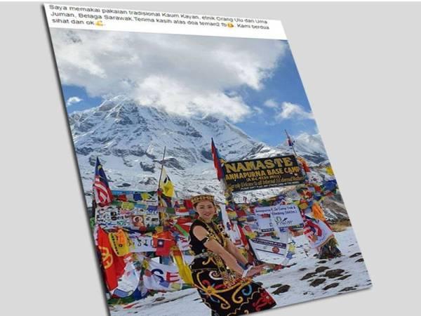 Gambar Nancy Maria menyarung pakaian entik Orang Ulu dari Uma Juman, Belaga, Sarawak di Annapurna Base Camp (ABC), Nepal mendapat perhatian netizen. - Foto Facebook Nancy Maria