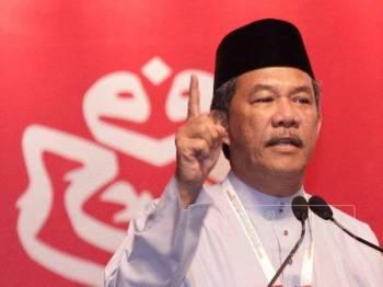 Timbalan Presiden UMNO, Datuk Seri Mohamad Hasan berucap di Perhimpunan Agung UMNO di Pusat Dagangan Dunia Putra (PWTC) di sini hari ini. - FOTO ZAHID IZZANI